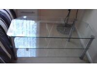 glass tv corner unit .very good condition.dimensions..h 50cmxw140cmxd50cm..