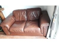 **FREE** 2 seater brown leather sofa
