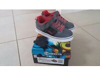 Heelys grey and red, size 3, worn only once, condition as new. Complete with original box.