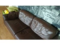 2 seater Sofa is in brown and as some cat scratches on the arms