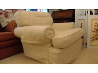 two squashy comfy armchairs with cream loose covers
