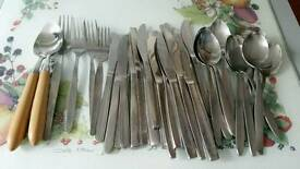 Assorted metal cutlery and 2 wooden handle spoons