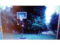 Full size adjustable basketball system