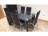 Glass Dining Table with 6 Leather Chairs