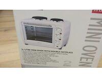Unused mini oven and grill