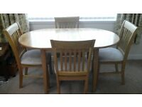 LIGHT OAK OVAL DINING TABLE AND CHAIRS £50