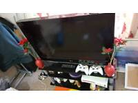37inch LG LCD TV with black glass table in excellent condition