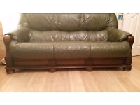 2 green leather sofas