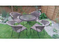 Rattan and Steel Garden table and 4 chairs