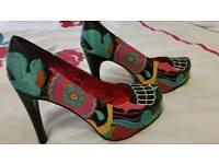 NEW. Ladies size 8 Iron fist platform shoes.