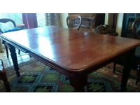 Edwardian mahogany wind-out dining table