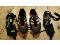 For sale are pair of Adiidas football boots and pair of Adidas Predator shin guards.