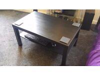 Black wood vinal coffee table with magazine shelf.