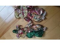 A set of Harlequin china/porcelain dolls