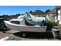 14ft Cabin Boat on trailer for sale.
