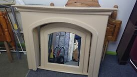 fire surround with hearth, mirror and lighting