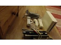 Wii console to sell in a good condition with games and balance board