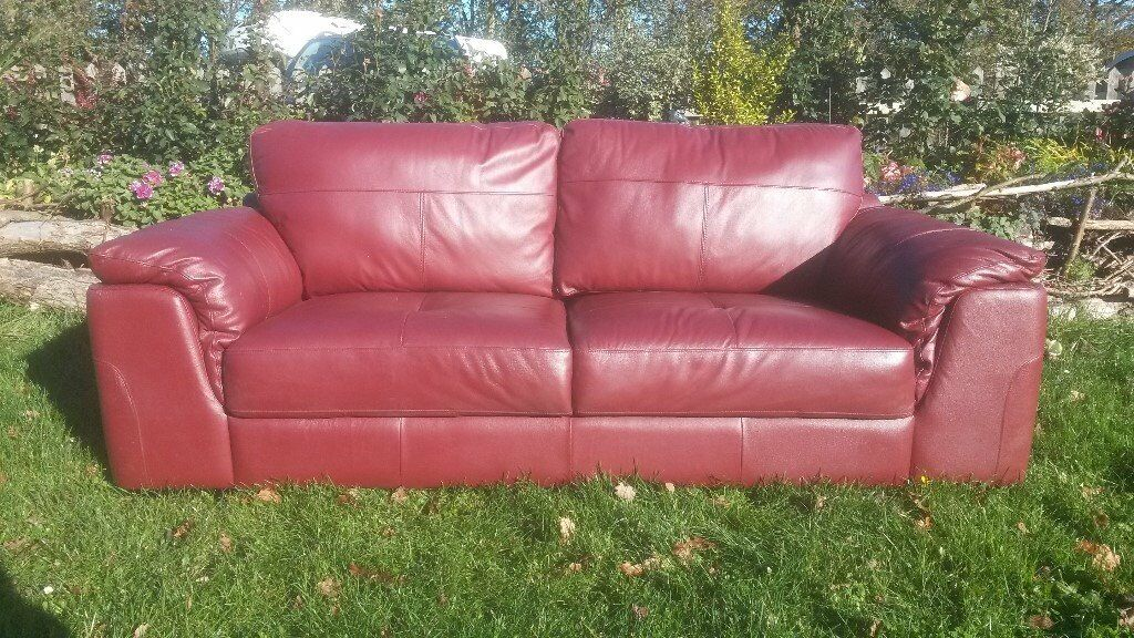 2 x Red Leather 2 seater sofas.