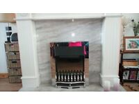 White wooden fire surround plus solid marble base and living flame effect electric fire.