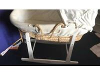 Moses basket with stand.