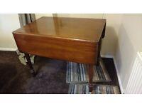Antique Pembroke mahogany dining room table