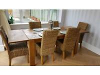 Next Hartford extendable dining table with 6 Next wicker chairs.
