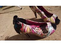 Very decorative high heeled shoes
