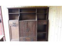 Antique oak dresser / sideboard ,tambour sliding doors and drop front drawers .