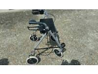 Four wheeled mobility walker with stick holder.
