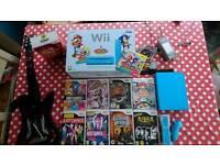 Nintendo wii Blue plus games