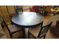 black extending table with 4 chairs