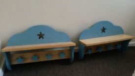Matching set of wooden Kids shelves with star clothes hangers underneith