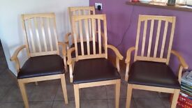 4 DINING CHAIRS - CARVERY TYPE- LIGHT WOOD WITH BROWN FAUX LEATHER SEATS