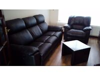 3 and 1 black leather reclining settee, with black leather-glass table. very good condition.