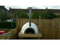 Outdoor woodfired oven. Woodfired Pizza oven.
