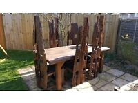 Eye catching 7 piece wooden garden/patio set - 6 Chairs 1 Table