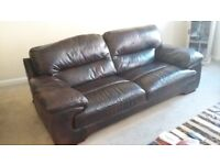 large 2 seater brown leather sofa with matching armchair and pouffe