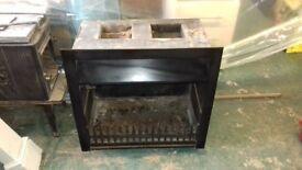 Open cast iron fire (Tortoise no 3) and slate hearth