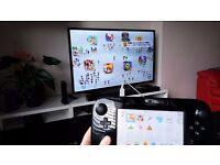 Nintendo Wii U 32 GB Black + Pro controller + 7 games (Mario kart 8, Mario Maker, Bayonetta 2 etc)