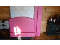 pink single bed frame and mattress