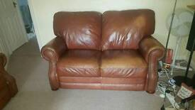 2 seat brown leather sofa used