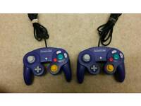 Two Official Game Cube controllers in purple