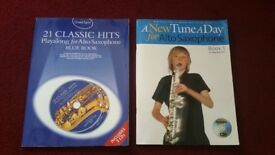 TWO SAXOPHONE TUITION BOOKS COMPLETE WITH CDs - AS NEW CONDITION