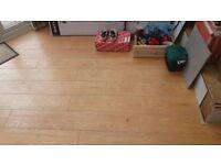 beach wood flooring and green foam square tile underlay