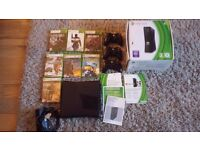 Xbox 360 + 3 Wireless Controllers + 7 Games