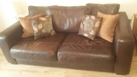 Brown leather sofas.