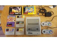 SUPER NINTENDO console + 6 games & controllers. Excellent condition, Works great!