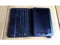 Samsung galaxy silver tablet with Bluetooth keyboard, magnetic black leather case and charge cables