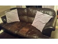 2 large brown leather 3 seater sofas for sale.