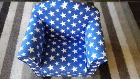 Childrens chair. Blue with star design. Solid wood frame. £15.